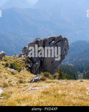 Heavy rock boulder presenting risk for anything in the valley - Stock Photo