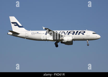 Finnish Finnair Airbus A320-200 with registration OH-LXF on short final for runway 01 of Brussels Airport. - Stock Photo