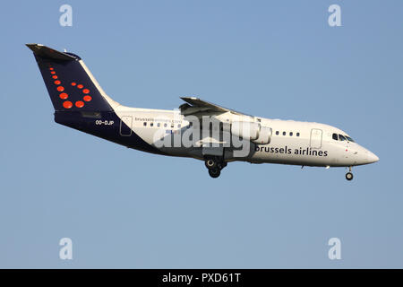 Belgian Brussels Airlines Avro RJ85 with registration OO-DJP on short final for runway 01 of Brussels Airport. - Stock Photo