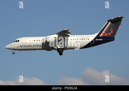 Belgian Brussels Airlines Avro RJ100 with registration OO-DWI on short final for runway 01 of Brussels Airport. - Stock Photo