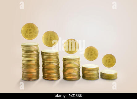 concept falling chart with golden bitcoin.on pink pastel minimal background - Stock Photo