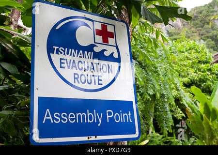 Tsunami evacuation route  sign. Krabi, Thailand - Stock Photo
