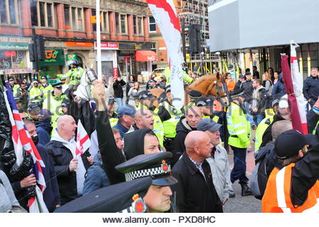 English Defence League Members Mingle With Police At The Stand Up To Racism Demonstration At Piccadilly Gardens Manchester UK. Afternoon - Stock Photo