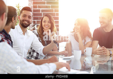 close-up of the creative team discussing - Stock Photo