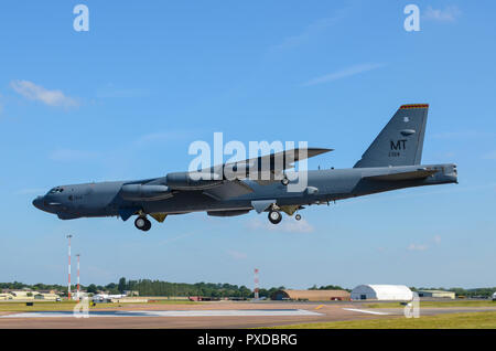 Boeing B-52 Stratofortress nuclear bomber landing at RAF Fairford for RIAT Royal International Air Tattoo. Space for copy - Stock Photo