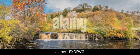 Yorkshire Dales National Park panoramic autumn landscape, vivid autumn colours at Wain Wath Falls, Swaledale, UK - Stock Photo