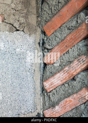 Closeup of the unfinished  brick wall in the under construction of the countryside house. - Stock Photo