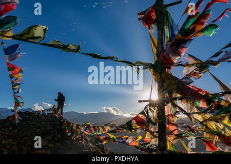 Silhouette of man watching the sunset at Namgyal Tsemo Gompa, Leh, Ladakh, Kashmir, India Stock Photo