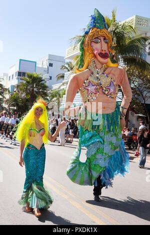 Miami Beach Florida Ocean Drive Art Deco Weekend historic district architecture festival event celebration parade giant dolls - Stock Photo