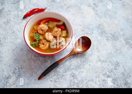Traditional Tom Yum spicy Thai soup with shrimp - Stock Photo
