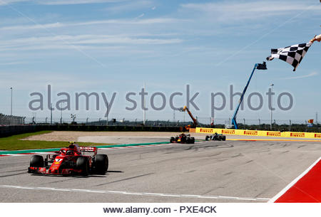 Texas, USA. 21st Oct 2018. Kimi Raikkonen, Ferrari SF71H, 1st position, takes the chequered flag ahead of Max Verstappen, Red Bull Racing RB14, 2nd position, and Lewis Hamilton, Mercedes AMG F1 W09 EQ Power+, 3rd position during the United States GP at Circuit of the Americas on October 21, 2018 in Circuit of the Americas, United States of America. (Photo by Glenn Dunbar / LAT Images) Credit: Motorsport Images/Alamy Live News - Stock Photo