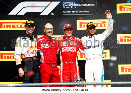 Texas, USA. 21st Oct 2018. Max Verstappen, Red Bull Racing, 2nd position, Carlos Santi, Race Engineer, Ferrari, Kimi Raikkonen, Ferrari, 1st position, and Lewis Hamilton, Mercedes AMG F1, 3rd position, on the podium during the United States GP at Circuit of the Americas on October 21, 2018 in Circuit of the Americas, United States of America. (Photo by Glenn Dunbar / LAT Images) Credit: Motorsport Images/Alamy Live News - Stock Photo