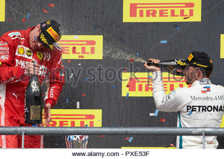 Texas, USA. 21st Oct 2018. Lewis Hamilton, Mercedes AMG F1, 3rd position, sprays Kimi Raikkonen, Ferrari, 1st position, with Champagne on the podium during the United States GP at Circuit of the Americas on October 21, 2018 in Circuit of the Americas, United States of America. (Photo by Steve Etherington / LAT Images) Credit: Motorsport Images/Alamy Live News - Stock Photo