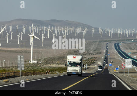 (181022) -- BEIJING, Oct. 22, 2018 (Xinhua) -- A truck runs on the road in Turpan, northwest China's Xinjiang Uygur Autonomous Region, Sept. 22, 2018. China's road freight transport continued fast expansion in the first nine months of 2018, the Ministry of Transport said in a statement Oct. 20, 2018. From January to September, the amount of cargo carried on roads, which takes up the lion's share in China's total cargo transport, increased 7.5 percent year on year to 28.64 billion tonnes. The growth came amid China's steady economic growth, which stood at 6.7 percent in the three quarters, abov - Stock Photo