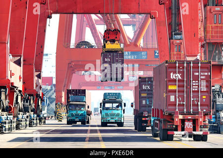 (181022) -- BEIJING, Oct. 22, 2018 (Xinhua) -- A container is loaded onto a truck at Jingtang port area of Tangshan Port, north China's Hebei Province, Jan. 13, 2018. In 2017. China's road freight transport continued fast expansion in the first nine months of 2018, the Ministry of Transport said in a statement Oct. 20, 2018. From January to September, the amount of cargo carried on roads, which takes up the lion's share in China's total cargo transport, increased 7.5 percent year on year to 28.64 billion tonnes. The growth came amid China's steady economic growth, which stood at 6.7 percent in - Stock Photo
