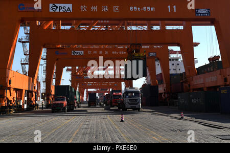 (181022) -- BEIJING, Oct. 22, 2018 (Xinhua) -- Trucks transport goods at Qinzhou port in Qinzhou, south China's Guangxi Zhuang Autonomous Region, Dec. 19, 2017. China's road freight transport continued fast expansion in the first nine months of 2018, the Ministry of Transport said in a statement Oct. 20, 2018. From January to September, the amount of cargo carried on roads, which takes up the lion's share in China's total cargo transport, increased 7.5 percent year on year to 28.64 billion tonnes. The growth came amid China's steady economic growth, which stood at 6.7 percent in the three quar - Stock Photo