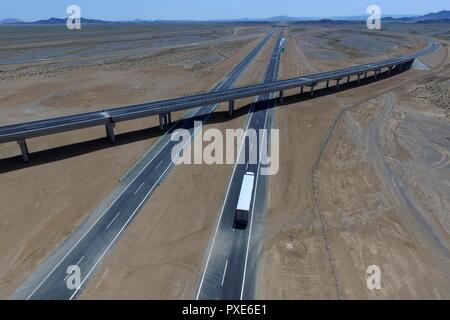 (181022) -- BEIJING, Oct. 22, 2018 (Xinhua) -- Aerial photo taken on July 15, 2017 shows a truck running on the Beijing-Urumqi Expressway in Hami, northwest China's Xinjiang Uygur Autonomous Region. China's road freight transport continued fast expansion in the first nine months of 2018, the Ministry of Transport said in a statement Oct. 20, 2018. From January to September, the amount of cargo carried on roads, which takes up the lion's share in China's total cargo transport, increased 7.5 percent year on year to 28.64 billion tonnes. The growth came amid China's steady economic growth, which - Stock Photo
