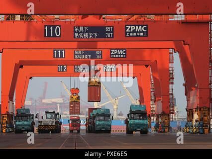 (181022) -- BEIJING, Oct. 22, 2018 (Xinhua) -- Containers are loaded onto trucks at Jingtang port area of Tangshan Port, north China's Hebei Province, July 8, 2018. The throughput of Tangshan Port reached 303 million tons from January to June this year, growing 7.28 percent year on year. China's road freight transport continued fast expansion in the first nine months of 2018, the Ministry of Transport said in a statement Oct. 20, 2018. From January to September, the amount of cargo carried on roads, which takes up the lion's share in China's total cargo transport, increased 7.5 percent year on - Stock Photo