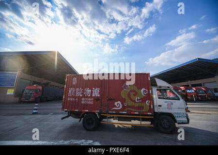 (181022) -- BEIJING, Oct. 22, 2018 (Xinhua) -- Photo taken on Oct. 11, 2018 shows a truck carrying packaged sweaters at a logistics center in Puyuan Town in Tongxiang, east China's Zhejiang Province. China's road freight transport continued fast expansion in the first nine months of 2018, the Ministry of Transport said in a statement Oct. 20, 2018. From January to September, the amount of cargo carried on roads, which takes up the lion's share in China's total cargo transport, increased 7.5 percent year on year to 28.64 billion tonnes. The growth came amid China's steady economic growth, which - Stock Photo