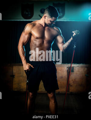 Male using resistance bands during training exercise - Stock Photo