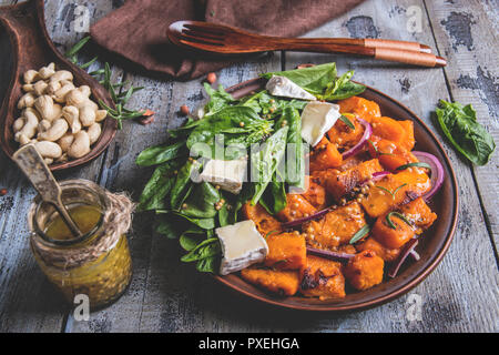 roasted pumpkin slices, spinach leaves, Camembert brie cheese, cashews, sauce. vegetarian salad ,dish - Stock Photo