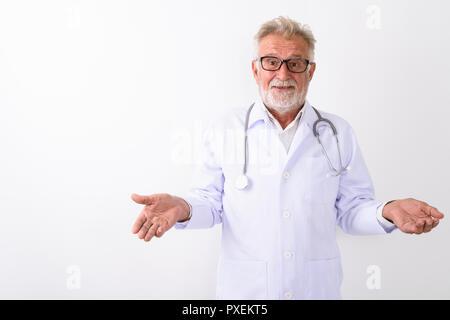 Studio shot of handsome senior bearded man doctor looking confus - Stock Photo