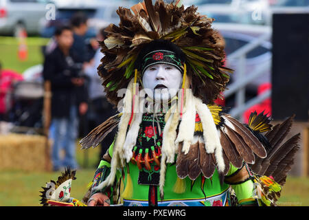 Native American dressed in traditional clothing at Pow Wow - Stock Photo