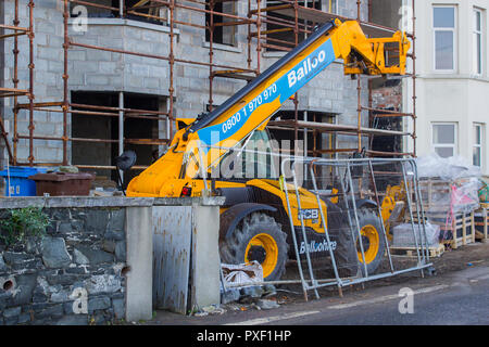 11 October 2018 A large Telescopic Loader used in the construction industry parked up on a small building site on the Seacliff Road in Bangor County D - Stock Photo