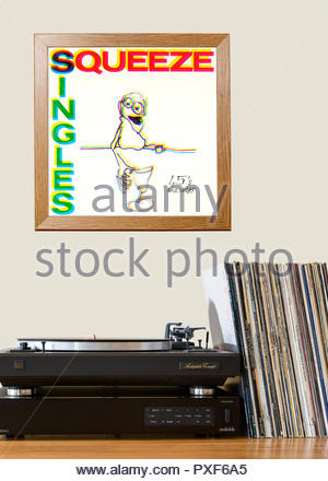 Record player and framed album cover Squeeze Singles album, England - Stock Photo