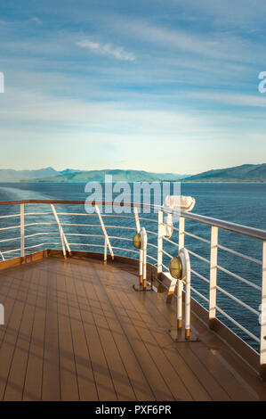 Exterior white metal light fixture and railing, port side on a cruise ship. Dixon Entrance, Inside Passage, British Columbia, Canada. - Stock Photo
