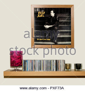 CD Collection and framed Billy Joel 1983 Album An Innocent Man, England - Stock Photo