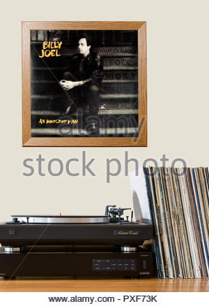 Record player and framed album cover Billy Joel 1983 Album An Innocent Man, England - Stock Photo
