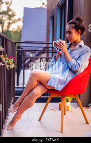 nice beautiful woman sitting on the chair