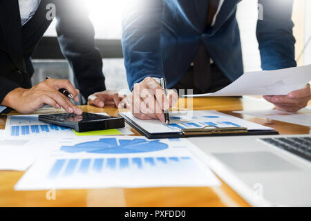 Team work process. young business managers crew working with startup project. laptop in office analyze profit graph plan. - Stock Photo