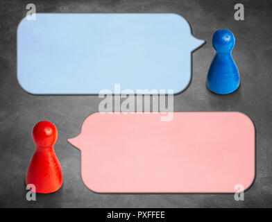 Game figures with angled speech bubbles with blackboard backgrou - Stock Photo