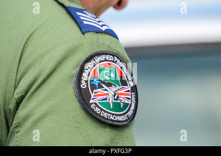 Badge worn by RAF Royal Air Force crew member depicting Operation Unified Protector, E-3D detachment Trapani 2011. Libyan civil war no fly zone - Stock Photo