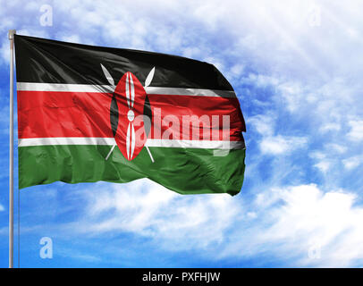 National flag of Kenya on a flagpole in front of blue sky. - Stock Photo