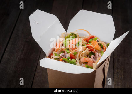 Noodles with seafood and vegetables - Stock Photo
