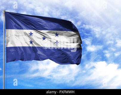 National flag of Honduras on a flagpole in front of blue sky. - Stock Photo