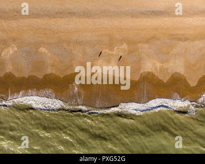 Big waves crashing to the beach aerial view top down - Stock Photo