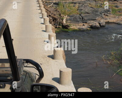 Giant Kingfisher on perch of road bridge in South Africa - Stock Photo