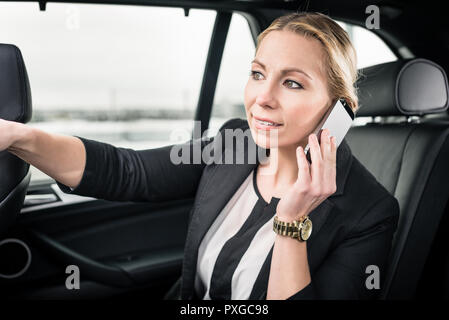 Overhead view of businesswoman travelling in the car - Stock Photo