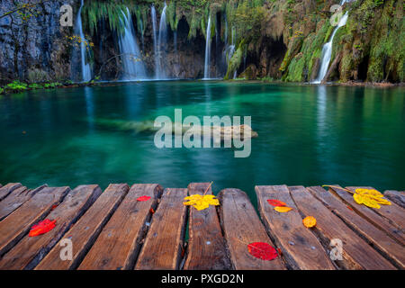Plitvice Lakes. Image of waterfall located in Plitvice National Park, Croatia during autumn day. - Stock Photo