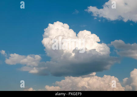 Beautiful cumulus cloudscape on a blue sky background. Photographed in Tyrol, Austria - Stock Photo