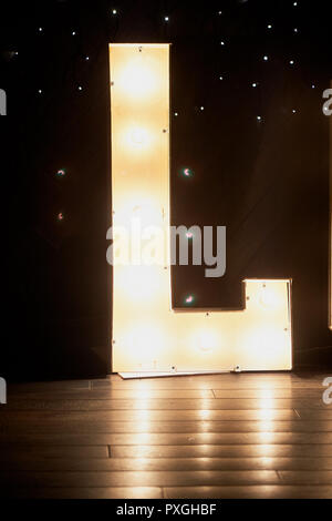 Glowing letters l in the design of a party night club. - Stock Photo