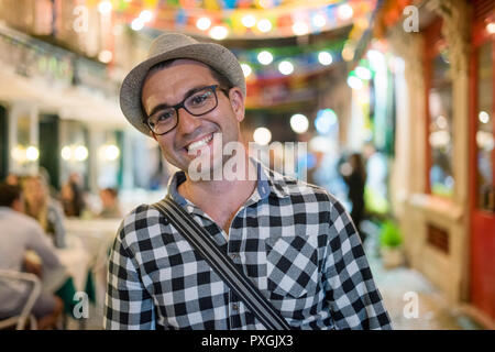 .Happy young man portrait, outdoor at night in urban settings - Stock Photo