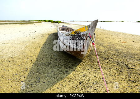 Old Fishermen Boat in a beach - Stock Photo