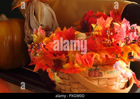 Fall Bench Display with leaves, pumpkins and corn, on the right side up close - Stock Photo