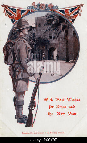 A rather unusual Christmas Greetings postcard, featuring a World War One era soldier (serving on the Mesopotamian front) in patriotic pose before an inset view of The Citadel, Baghdad, Iraq.      Date: circa 1916 - Stock Photo