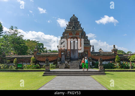 Badung, Indonesia - September 12, 2018: Tourists at the entrance of Taman Ayun temple, an ancient royal temple of Mengwi Empire. - Stock Photo